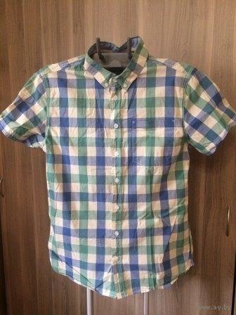 Стильная рубашка в клетку на 44-46 размер. Длина 71 см, ПОгруди 50 см, рукав короткий, идеальное качество и состояние, 100% хлопок. Не подошла нам по размеру, только постирали. Покупали за 65 рублей.